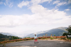 Girl skateboarding in tropical jungle mountains travelling asia Stock Images