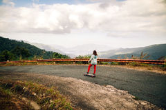 Girl skateboarding in tropical jungle mountains travelling asia Stock Photos