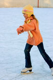 Girl skater. Winter skating rink Stock Image