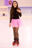 Girl skater. Beautiful young teen  skating on ice Stock Images