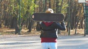 Girl skater goes away stock video