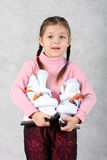 The girl with skates. The girl in hands holds figured skates Royalty Free Stock Images