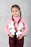 The girl with skates Royalty Free Stock Photo