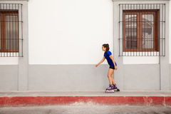Girl skating in the city Royalty Free Stock Photography