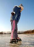 Girl skating on ice Stock Images