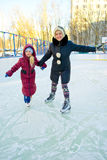 Girl skating on ice. Girl on a sunny day skating on ice stock photos