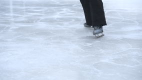 Girl skating on ice in the winter. stock footage