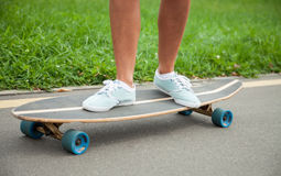 Girl skating on a longboard Stock Photo