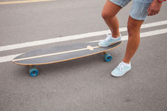 Girl skating on a longboard outdoors Royalty Free Stock Images