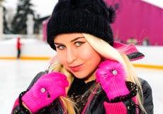 Girl on skating-rink stock photo