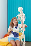 Girl and the skeleton Royalty Free Stock Photo
