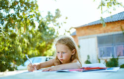 Girl with sketch pen drawing Royalty Free Stock Photo