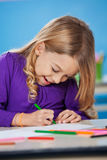 Girl With Sketch Pen Drawing In Kindergarten Royalty Free Stock Photography