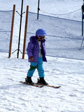 Girl and ski Stock Images