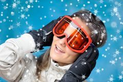 Girl in ski clothes Stock Images