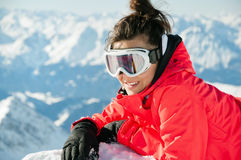 Girl with ski equipment on top of the mountain Royalty Free Stock Image