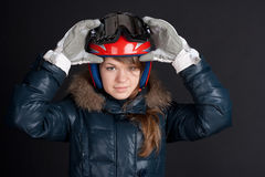 A girl in a ski helmet and goggles. On your head Royalty Free Stock Photo