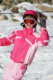 Girl ski skiing smiling winter snow rest vocation pink children kid trip travel Stock Photo