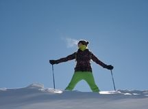 A girl in a ski suit Royalty Free Stock Photography