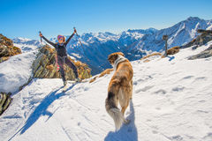 Girl ski touring in the mountains with dog Royalty Free Stock Photo