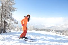 Girl with ski in the winter landscape Royalty Free Stock Image