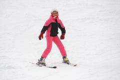 Girl skier Stock Images