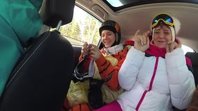 Girl skier having fun with the music in the car on the trip stock video footage