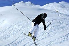 Girl skier jumping Royalty Free Stock Photos