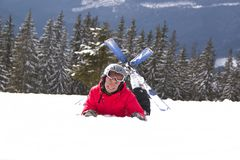 Girl skier lie on the snow Royalty Free Stock Image