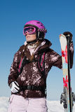 Girl skier with skis Royalty Free Stock Photography