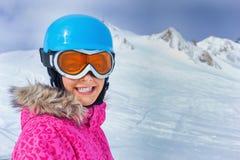 Girl skier in winter resort Stock Images