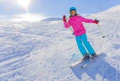 Girl skier in winter resort. Skiing, winter, child - young skier in winter resort Royalty Free Stock Photos