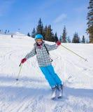 Girl skier in winter resort. Skiing, winter, child - young skier in winter resort Stock Images