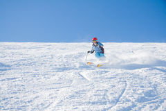Girl skiing. Young girl have a fun skiing on slope of mountain Stig Stock Photography