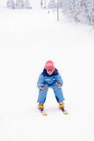 Girl skiing downhill Stock Photo