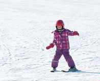 Girl is skiing downhill Royalty Free Stock Photo