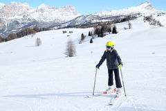 Girl is skiing in the italian alps. A young girl is skiing in the italian alps Stock Photography