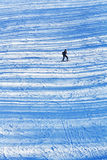 Girl skiing on the late afternoon snowy slopes with transversal stock images