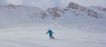 Girl skiing in the mountains Stock Image
