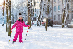 Girl is skiing in snow Park Royalty Free Stock Images