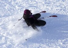 Girl skiing in the snow in winter.  Royalty Free Stock Image