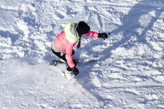 Girl skiing in the snow in winter.  Stock Images