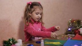 Girl skin application. preschool development of creativity. Beautiful little girl is engaged in creativity stock video footage