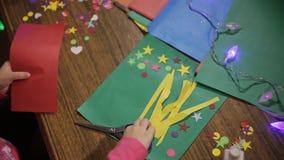 Girl skin application. preschool development of creativity. Girl learns scissor paper. development of children's creativity stock video footage