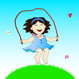 Girl with skipping rope. Little girl jumps on a skipping rope Royalty Free Stock Photos