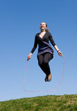 Girl with skipping rope Royalty Free Stock Photography