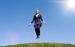 Girl with skipping rope Stock Images