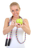 Girl with skipping rope and apple Royalty Free Stock Photos