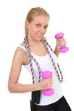 Girl with skipping rope and dumbbells Stock Photo