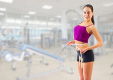 Girl with skipping rope at gym club Stock Photography